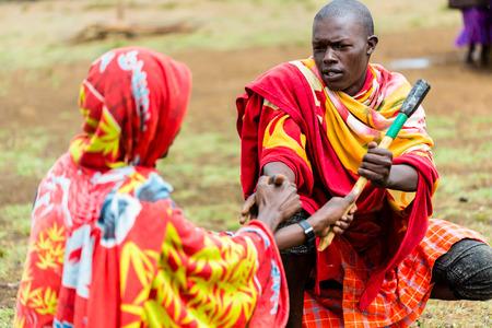 Massai men shaking hand concluding an agreement