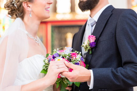 marrying: Bridal couple in church having wedding