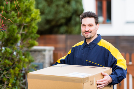 Courier delivering parcel to recipient Stock Photo