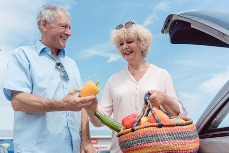 Low-angle view of a cheerful senior couple with a healthy lifestyle happy for buying fresh and nutritious vegetables from the hypermarket Stock Photo