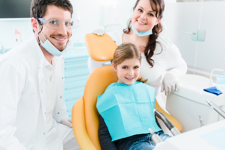 Dentist treating child in his surgery, there is no need to drill a tooth