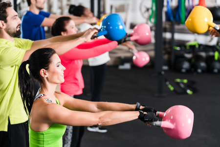 Functional fitness workout in sport gym with kettlebell Stock Photo