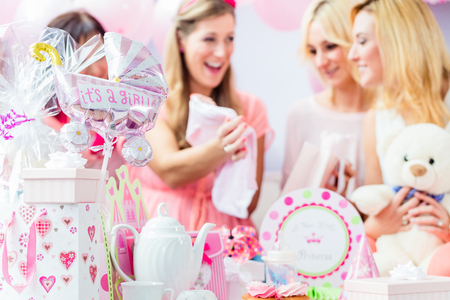 Best Friends on baby shower party celebrating giving kid stuff as present Stock Photo