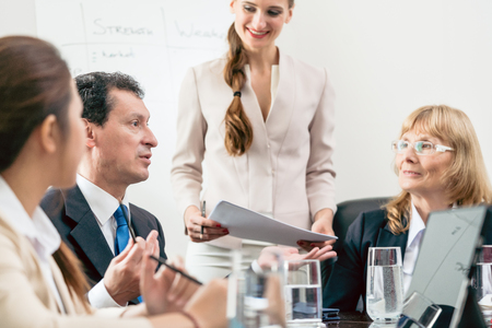 Dedicated manager sharing his opinion while interpreting a pie chart during board of directors meeting in the conference room of a prosperous company Stock Photo