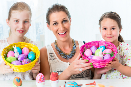 Basket with Easter eggs having been colored by family