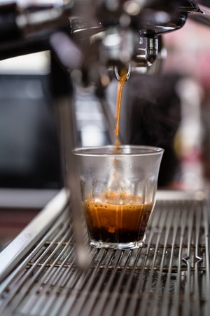 Detail of preparing coffee specialty, brewing with espresso maker Stock Photo