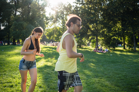 Man and woman dancing Latin American in summer park