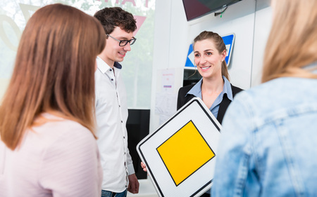 Theoretical lessons in driving school given by instructor Stock Photo