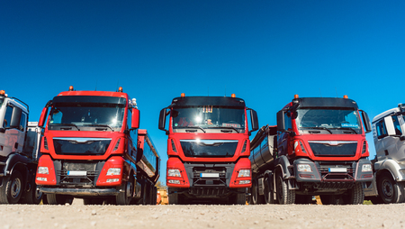 Trucks standing in line on premises of freight forwarding company Stock Photo