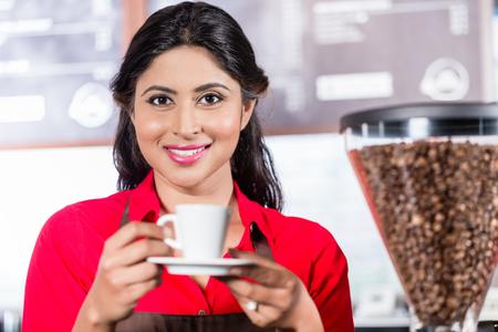 Female barista preparing coffee in Indian Cafe Stock Photo