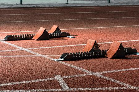 Close view of starrting blocks at cindertrack of athletics stadium