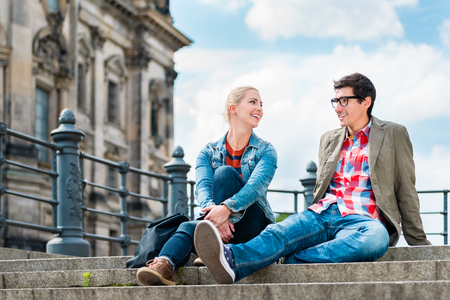 tourists, woman and man, enjoying the view from bridge at the Museum Island in Berlin
