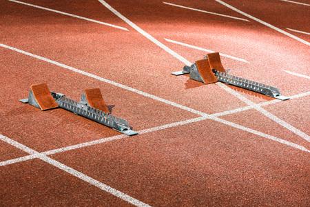 Starrting blocks at cinder track of athletics stadium 写真素材