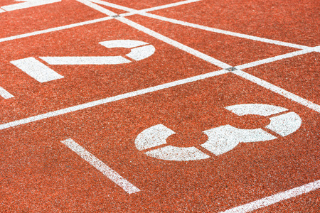 Side view of starting numbers of running track in sports stadium