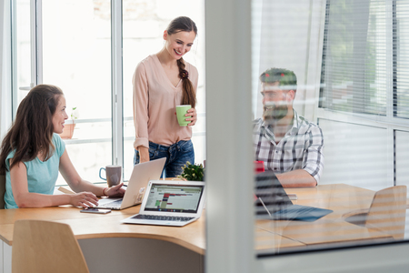 Close-up of the interior window of a modern work hub with shared collaborative offices for freelancers and independent contractors Stock Photo