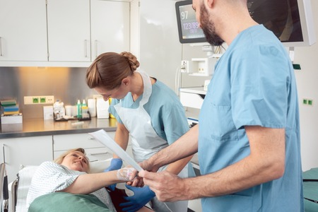 Doctor greeting patient before starting treatment in hospital