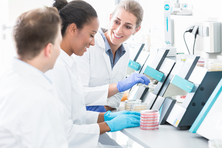 Group of researchers using scientific technology for test of germ samples