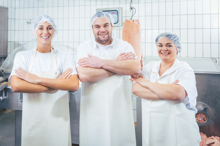Team of butchers showing thumbs up as a recommendation