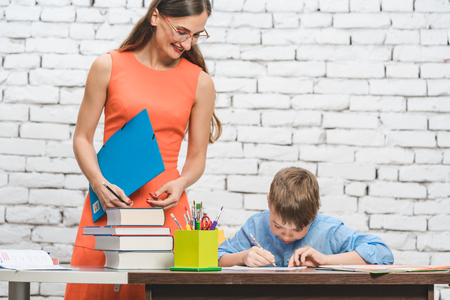 Teacher woman helping student with difficult task in school Stock fotó