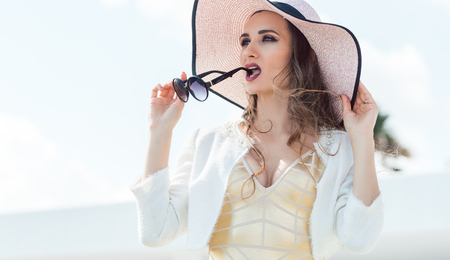 Woman with fashion sunglasses and sun hat