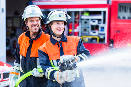 Fire fighters from fire brigade extinguish fire