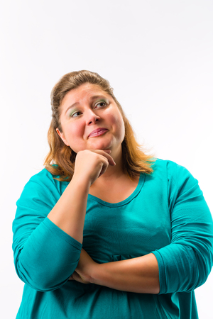 Portrait of smiling thoughtful fatty woman isolated over white background