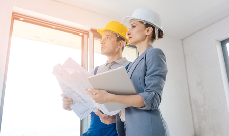 Project owner and construction worker during acceptance checking quality of work Stock Photo