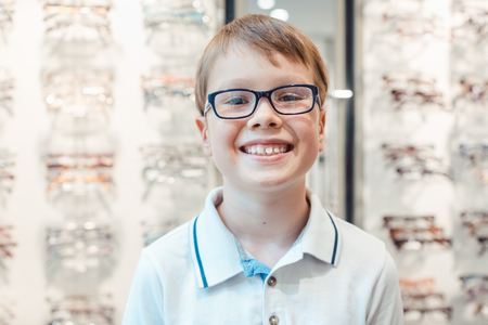 Young boy liking the new glasses he has got from the optician smiling Stock Photo