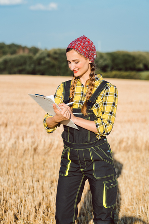 Farmer doing business administration and controlling on the field