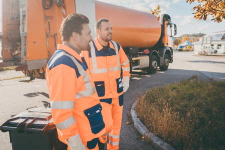 Two garbage removal service workers having short break from their job Standard-Bild
