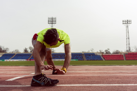 Healthy fit man stretching his body during exercise