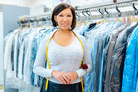 Smiling small business owner woman in a textile cleaning shop