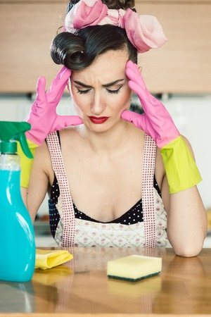 Stressed housewife having headache and migraine wishing she had a career or married a very rich guy