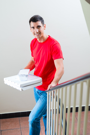 Portrait of smiling fast food delivery man with parcel Stock fotó - 122682657