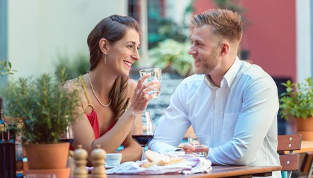 Portrait of a young couple enjoying at a restaurant