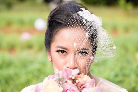 Happy Indonesian bride on her wedding