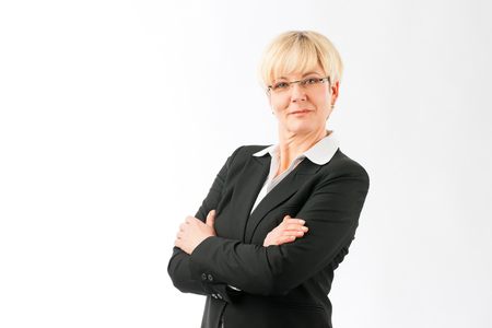 Close-up of confident mature businesswoman with her crossed arms isolated over white background