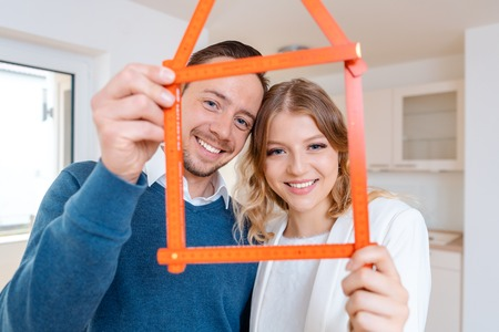 Woman and man having had success in finding a new apartment wanting to move in