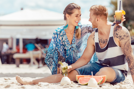 Happy young couple enjoying together at beach