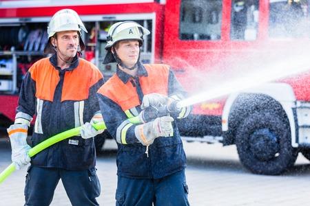 men of the fire brigade extinguish fire