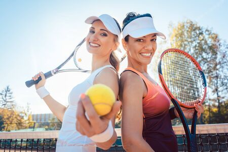 Best Friends of the tennis court with balls and rackets Stock fotó