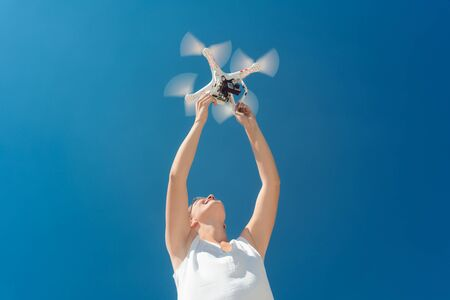 Woman starting a drone for a video production from her hands Stock fotó