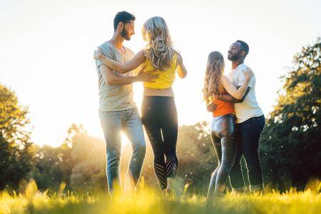 Women and men having fun dancing in the park as couples Reklamní fotografie