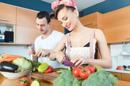 Couple preparing healthy food in the kitchen together