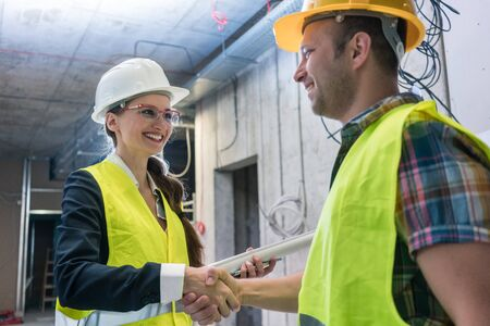 Handshake on the construction site after acceptance