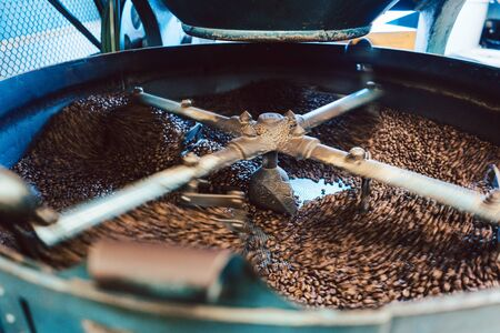 Coffee roaster machine in action mixing the beans