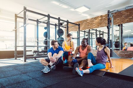 Group of diversity people having fun in the gym exercising together Banco de Imagens