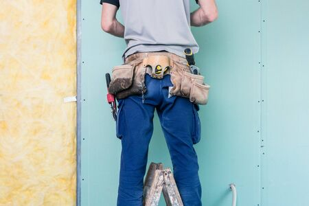 Construction worker completing the interior of a building