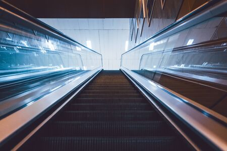 Escalator to the subway station in eerie light