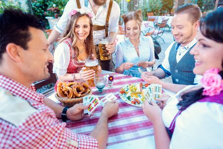 Traditional card game of Schafkopf in a German beer garden Stock fotó